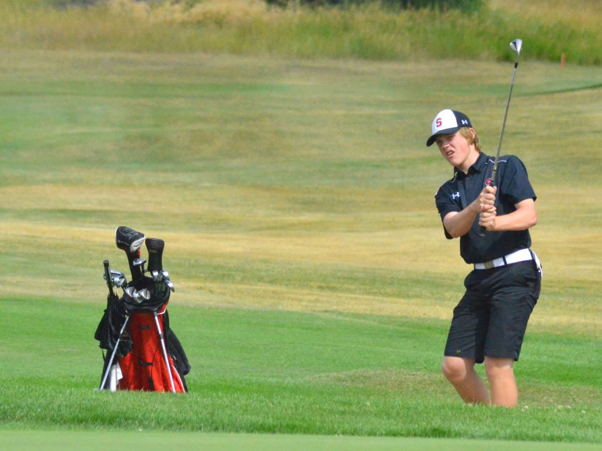 Steamboat Springs High School's Colton Sankey chips onto the 18th green Monday at Yampa Valley Golf Course in Craig. The Sailor varsity boys golf team shot a 252 to place sixth at the Moffat County High School Invitational.