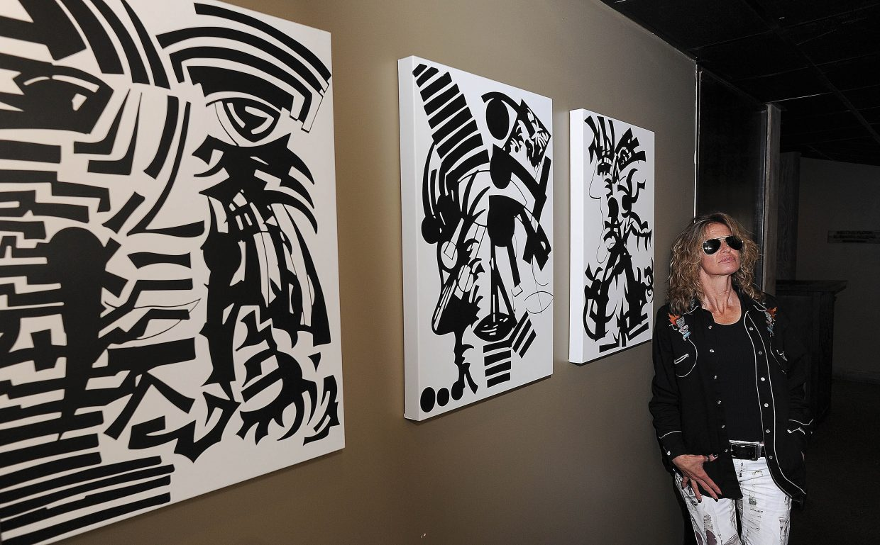 Leigh Erceg stands in front of her art at the E3 Chophouse in Steamboat Springs.