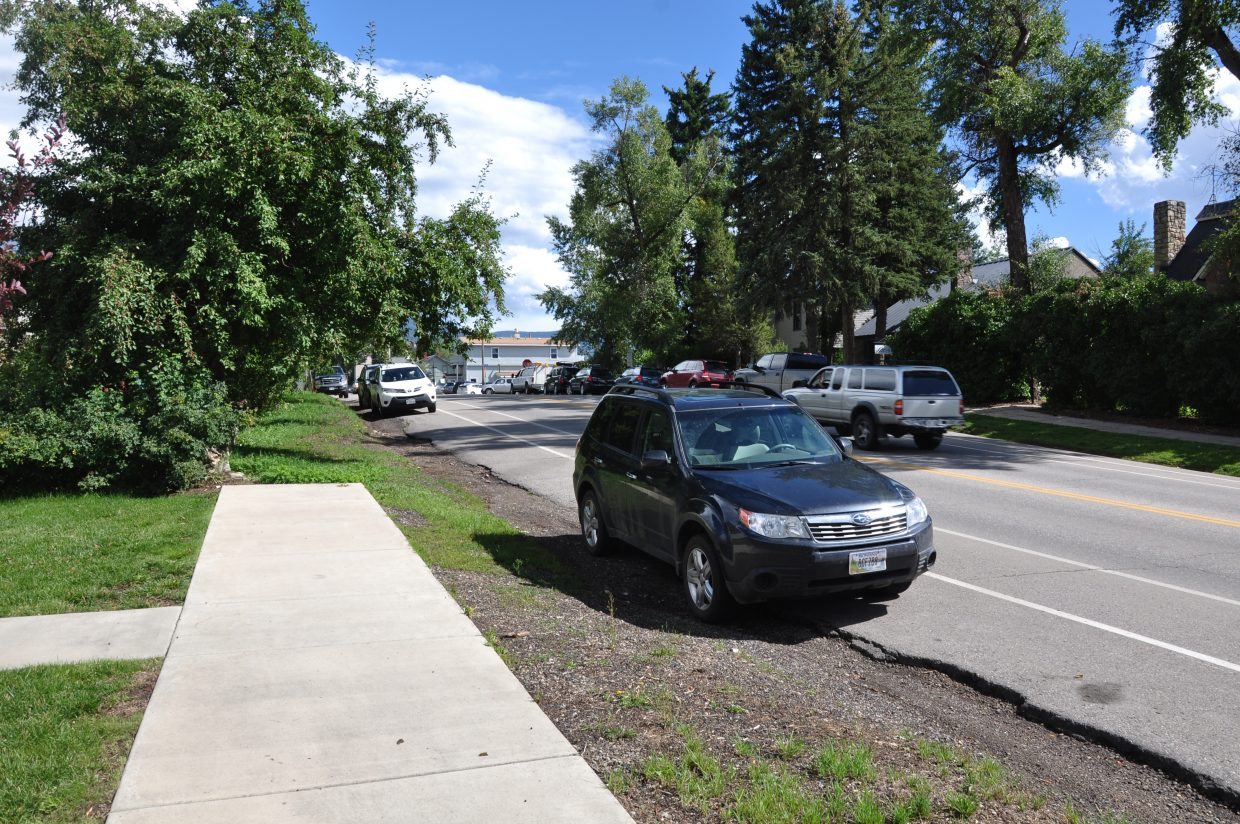 A sidewalk on Oak Street in downtown Steamboat Springs suddenly ends near the street's intersection with 10th Street.