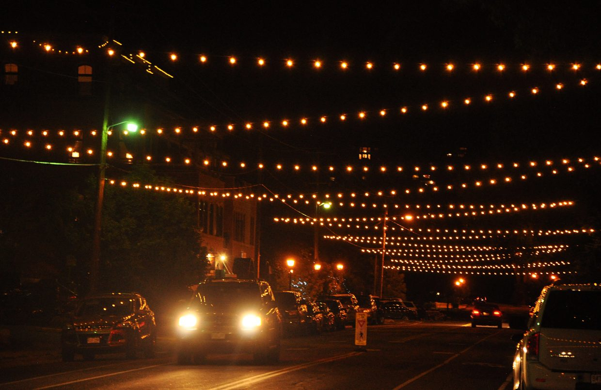 Traffic moves under the new festive-style lights on Yampa Street on Monday evening. The city of Steamboat Springs will resume talks about using tax increment financing downtown Sept. 2 amid some concern from Routt County and Steamboat Springs School District officials.