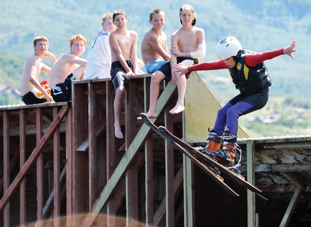 Nordic jumper Reid Sias takes a turn on the freestyle jumps at Bald Eagle Lake on Monday morning. The Nordic jump program held an end-of-summer party for its athletes. The young Olympic hopefuls headed back to school Tuesday after spending most of the summer on the jumps.