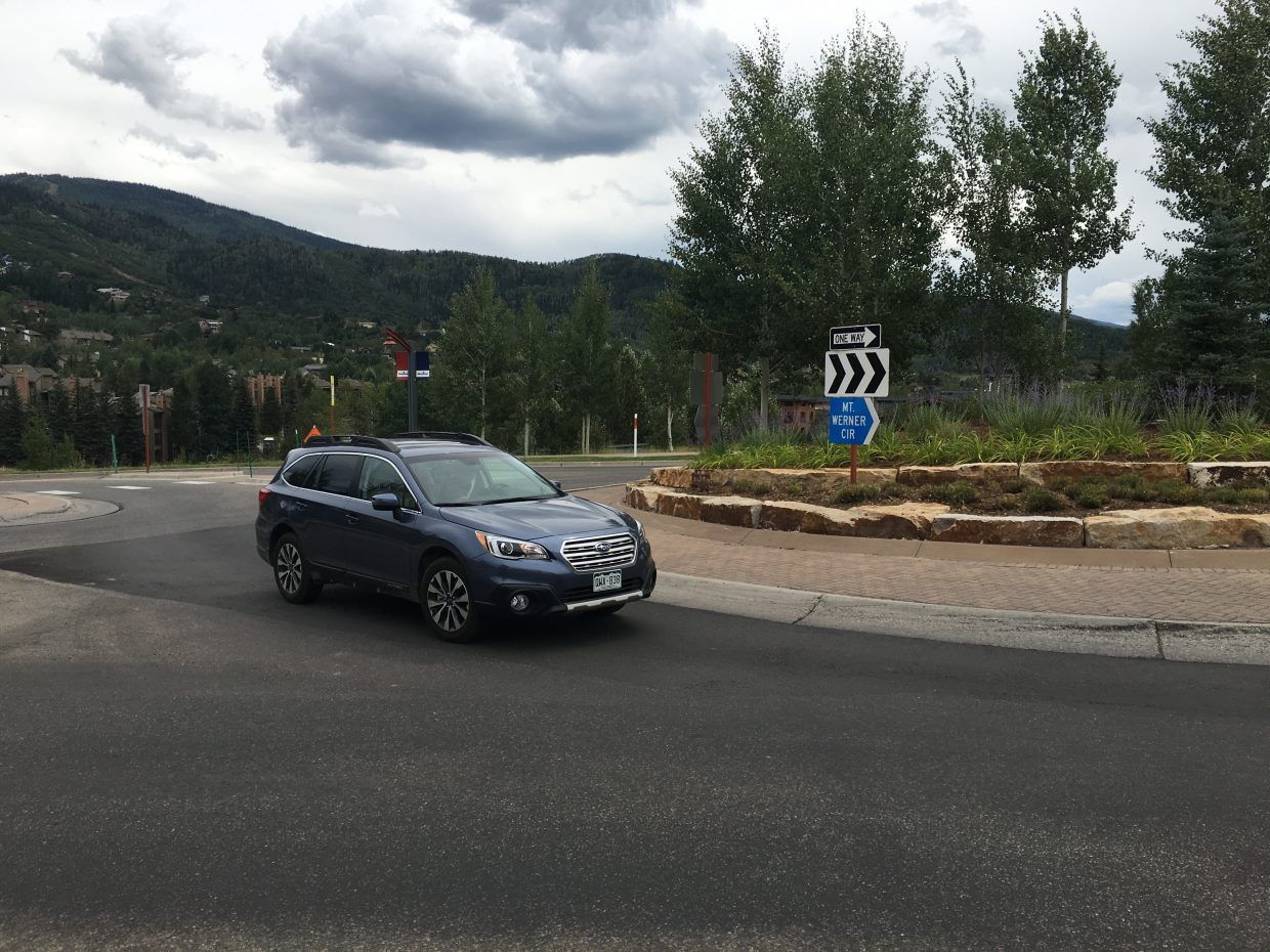 The intersection of Apres Ski Way and Mount Werner Circle demonstrates how a traffic roundabout can also host landscaping and provide directional signage.