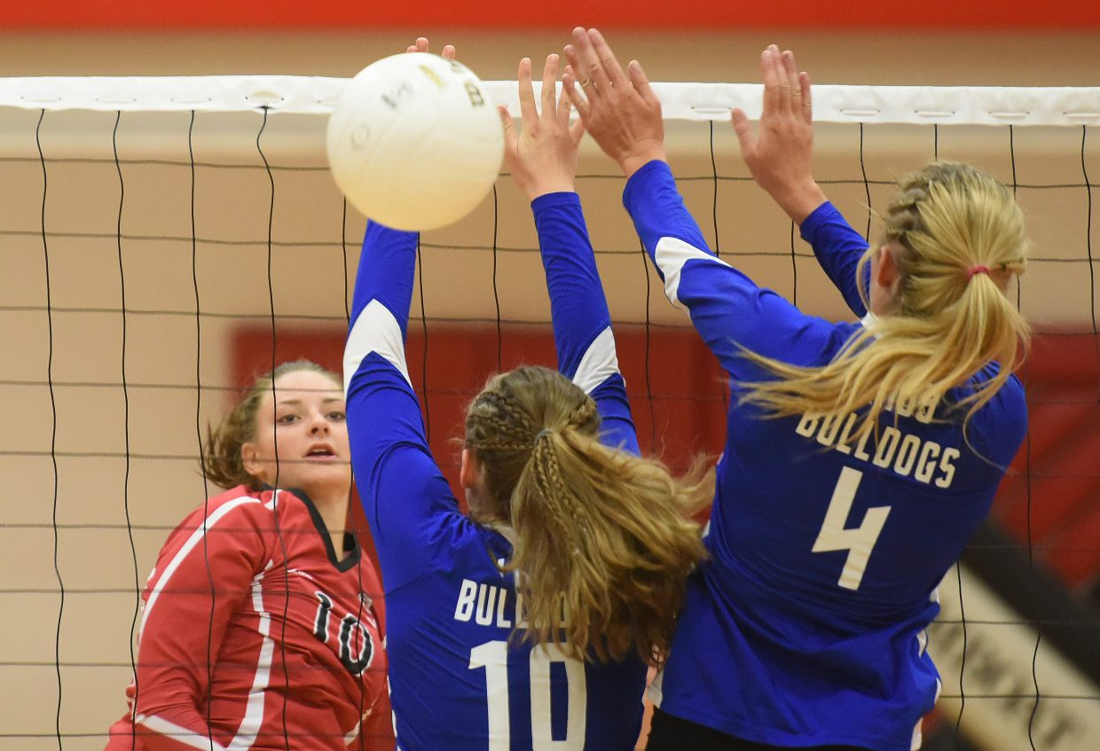 Steamboat Springs sophomore Anna Allsberry falls away after knocking a kill past the Moffat County block on Thursday. Steamboat beat it's Northwest Colorado rival in three sets.