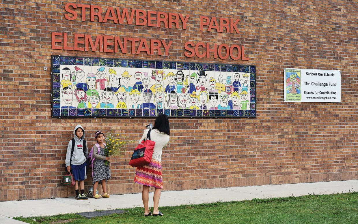 Joe and Gabriella Scoppa pose while mom, Lesa, takes a photograph on the first day of classes at Strawberry Park Elementary School. First through 12th grade headed back to classes in Steamboat Springs on Tuesday and kindergarten will follow Wednesday.