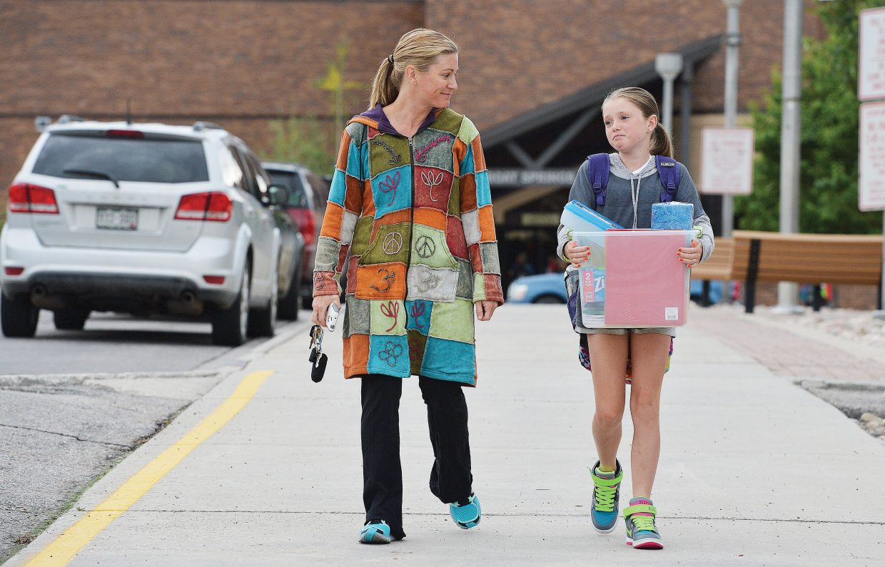 Sadie Havel is escorted by her mom, Erin, on the first day of classes at Strawberry Park Elementary School. Tuesday was the start of a new school year in Steamboat Springs for grades first through 12th. The kindergartners will head to class Wednesday.