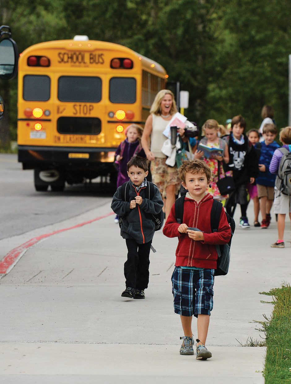 Cully Hartsel heads to class during the first day of school in Steamboat Springs on Tuesday. Hartsel and his classmates were doing their best to beat the bell at Strawberry Park Elementary School along with every other first- through 12th-grade student in town.
