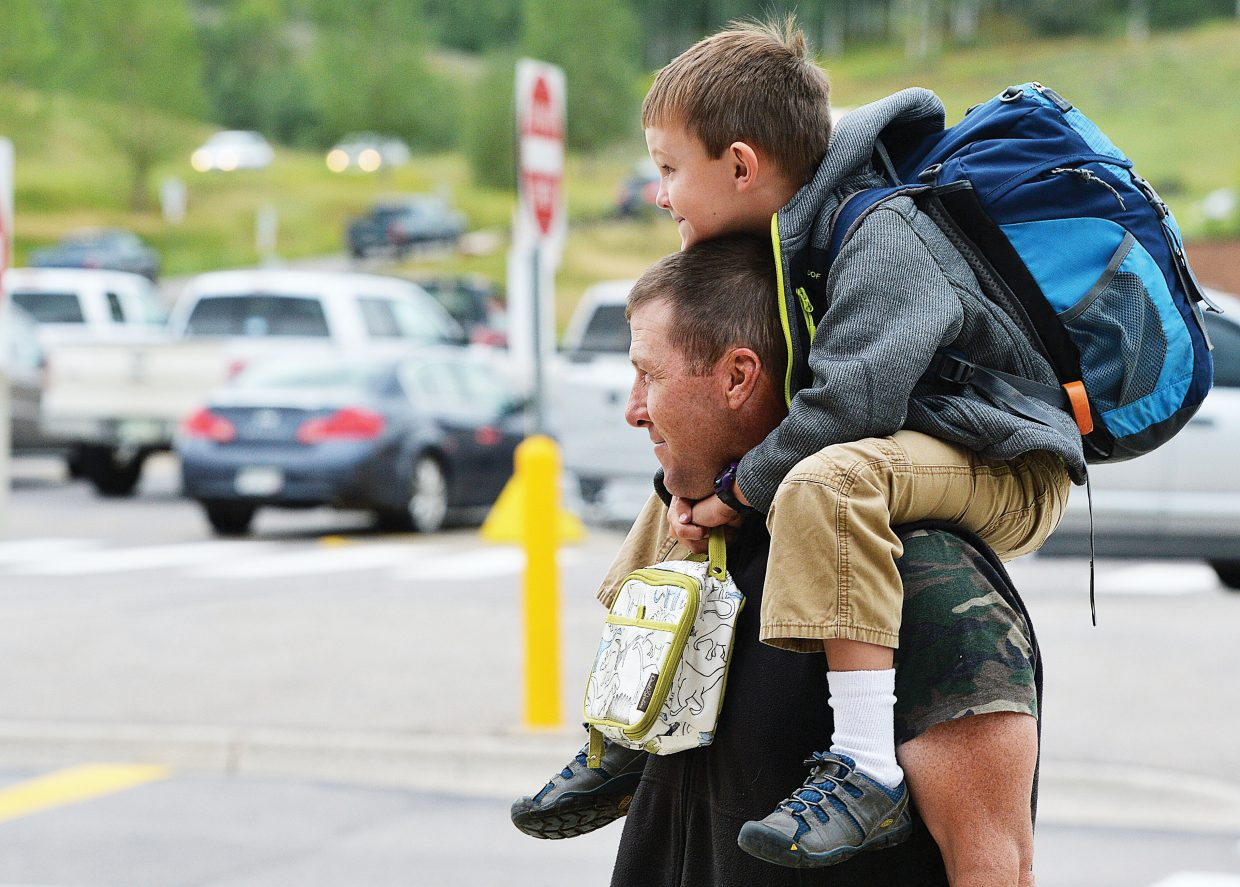 Luke Bedell got to ride to his first day of classes at Strawberry Park Elementary School thanks to his dad, Travis. Tuesday was the start of a new school year in Steamboat Springs for first through 12th grades. The kindergartners will head to class Wednesday.