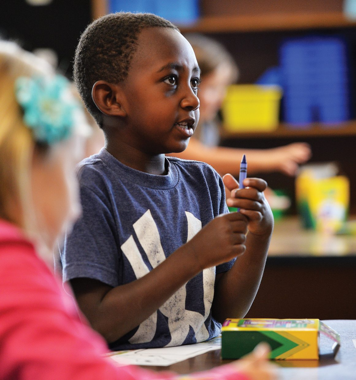 First-grader Taye Dover checks out the crayons while completing a nametag on the first day of classes at Soda Creek Elementary School. First through 12th grade headed back to classes in Steamboat Springs on Tuesday and kindergarten will follow Wednesday.