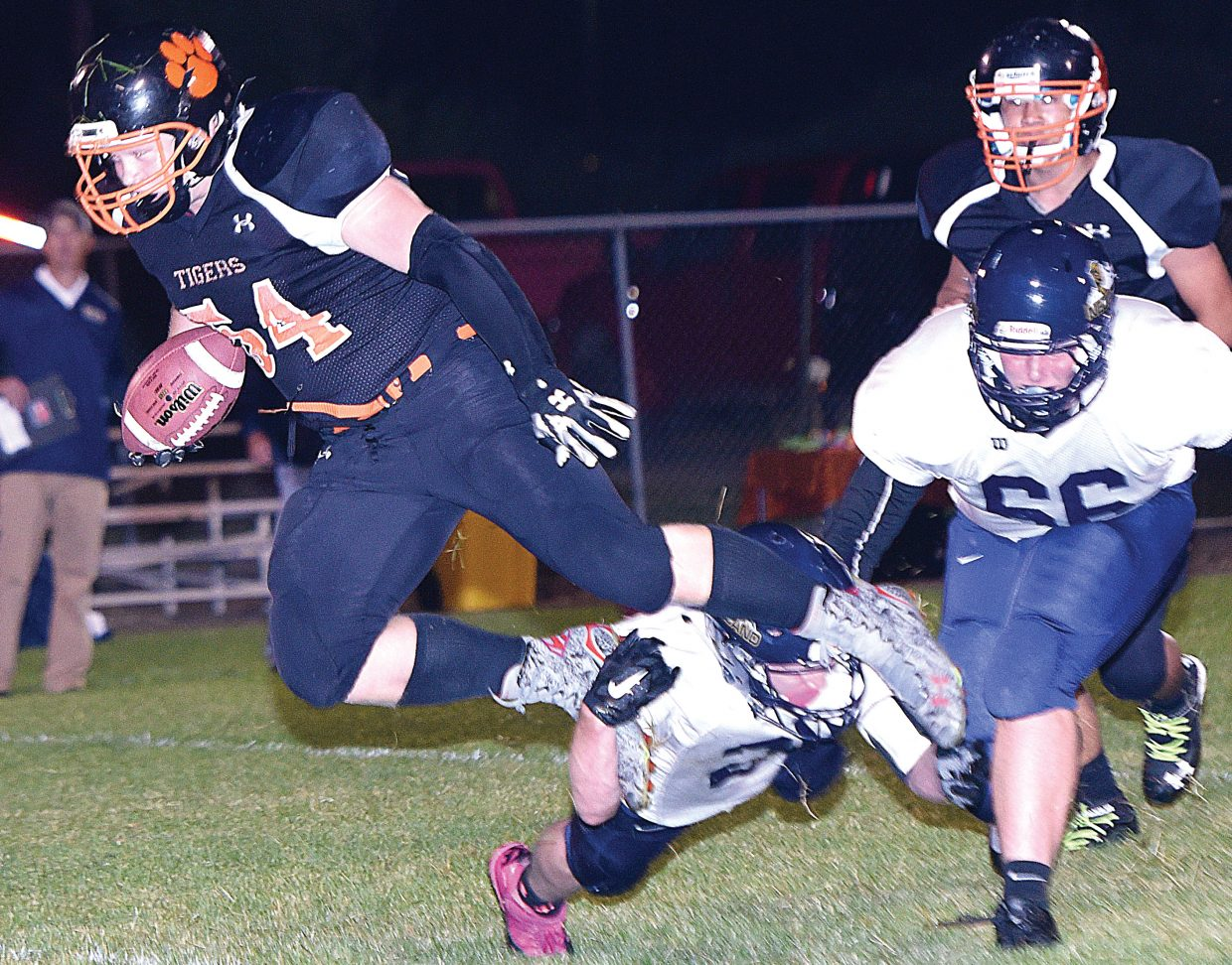 Hayden's Christian Carson is tripped up after a Nederland player made a nice open field tackle in Friday's game in Hayden. Carson, however, picked up a first down on the play and helped Hayden win the season opener with two touchdowns in the game. The Hayden Tigers topped the Nederland Panthers, 12-6.