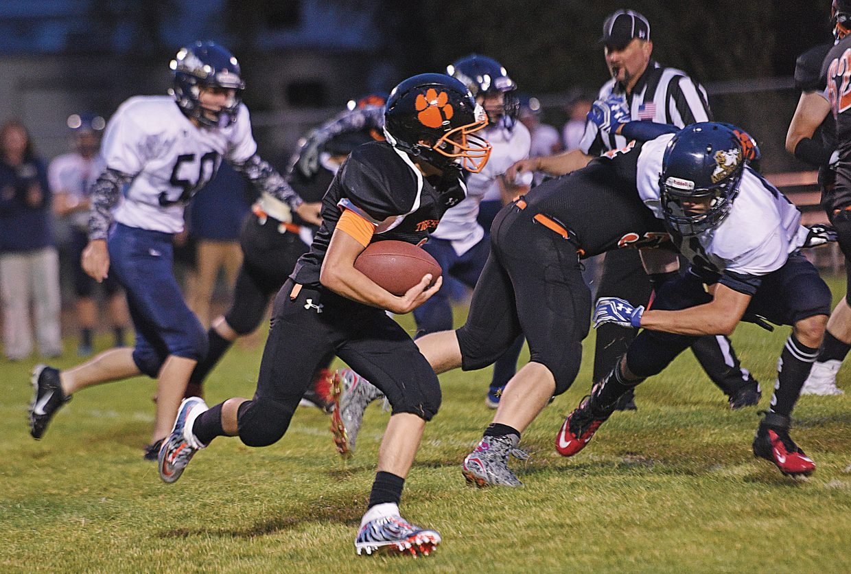 Hayden's Daylon Frentress rushes the ball past several Nederland players during Friday's 12-6 victory over Nederland in the season opener. Hayden's Christian Carson scored two touchdowns in the game.