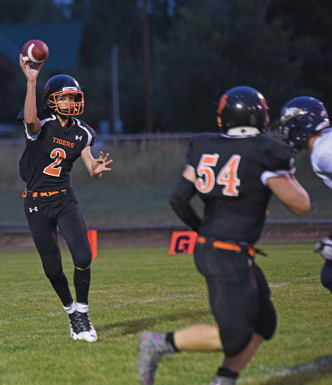 Hayden's quarterback Garrett St. Clair tosses a pass to Christian Carson in the first half of Friday's game in Hayden. The Hayden Tigers topped the Nederland Panthers, 12-6, in their season opener.