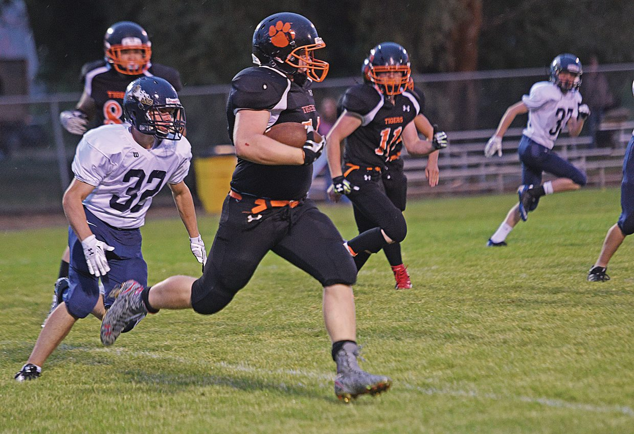 Hayden's Christian Carson returned this second quarter kickoff more than 90 yards before being knocked out of bounds. Carson scored a few plays later and helped Hayden win its season opener at home with two touchdowns in the game. The Hayden Tigers topped the Nederland Panthers, 12-6.