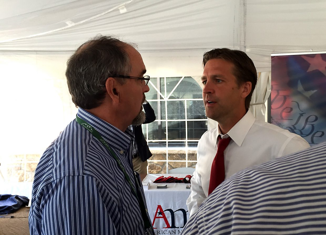 """U.S. Sen Ben Sasse (R-Nebraska), right, speaks with attendees of the Eighth annual Freedom Conference, being held this weekend at the Steamboat Grand. Sasse delivered the conference's kickoff address, titled """"The American Idea After 2017,"""" at noon Friday."""