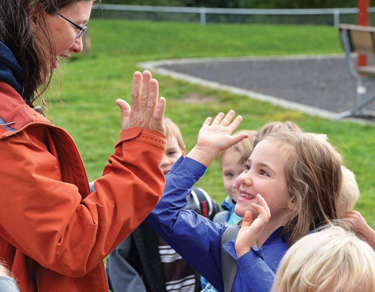 Liza Rossi gives her daughter, Shea, a high-five before the kindergartner headed off to her first day of class at Soda Creek Elementary School on Wednesday morning. While most of the school district began classes on Tuesday, kindergartners didn't start classes until Wednesday.