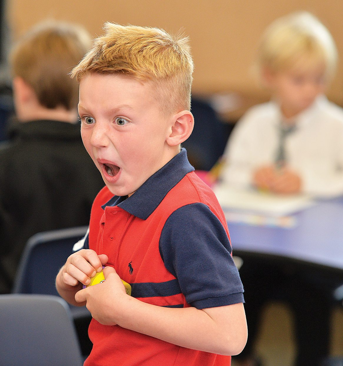 Kindergartner Sean Struble reacts while attempting to open a can of Play-Doh on the first day of class at Soda Creek Elementary School. Most of the school district began classes Tuesday, but kindergartners didn't start classes until Wednesday.