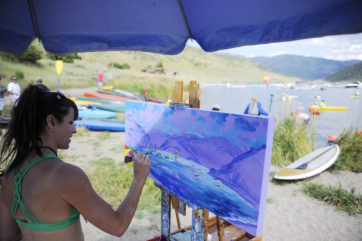 Julia Dordoni paints the scene at Stagecoach Lake State Park on Saturday.