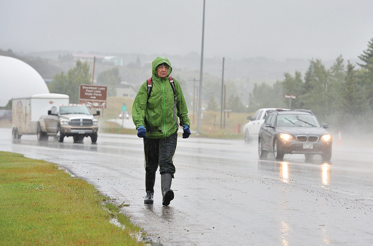 Halina Palmer, of Boulder, was forced to walk in the rain Thursday morning while visiting Steamboat Springs. Her car had broken down the night before, but luckily, she had plenty of rain gear after several days of camping in North Routt.