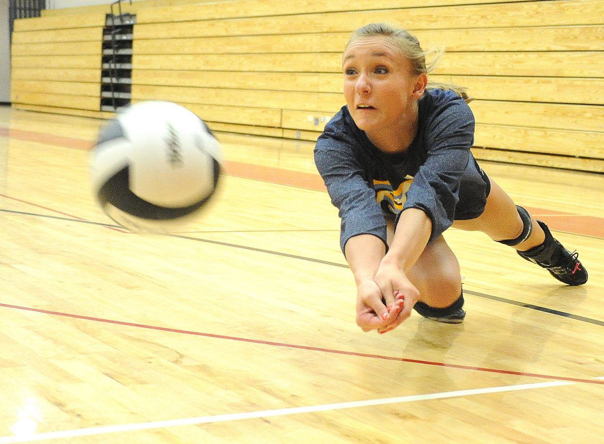 Steamboat Springs senior Madi Owen dives for a ball during volleyball practice Wednesday. The Sailors kick off their volleyball season Friday with the start of a tournament in Glenwood Springs.