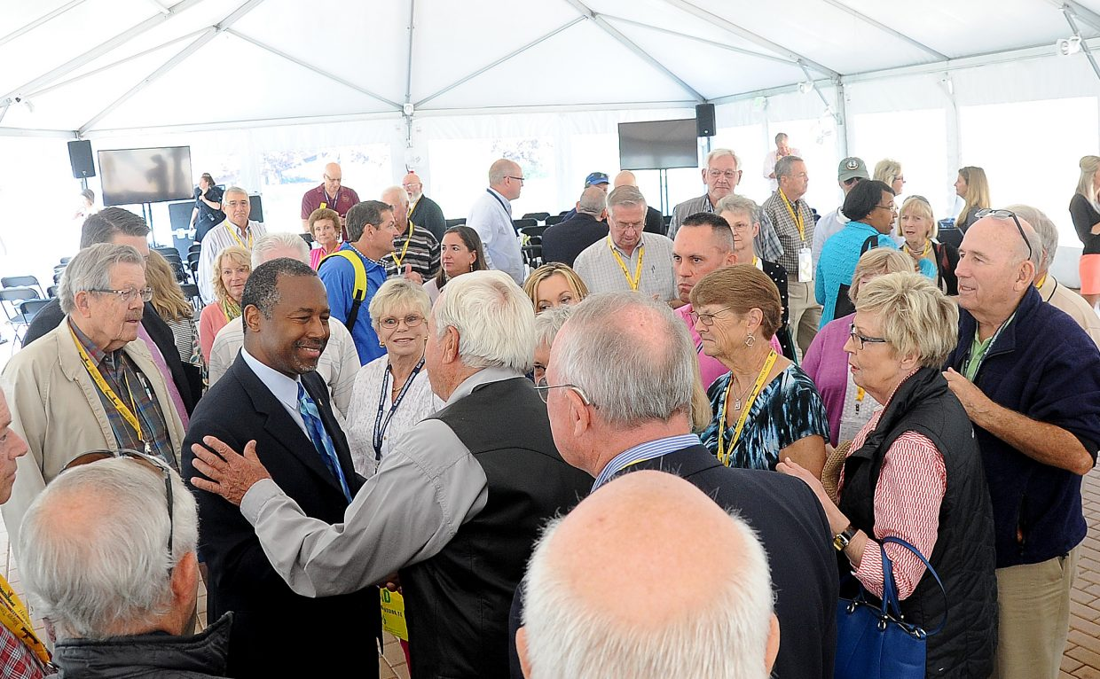 Former Republican presidential candidate Ben Carson mingles with attendees in the festival tent during the 2015 Freedom Conference.