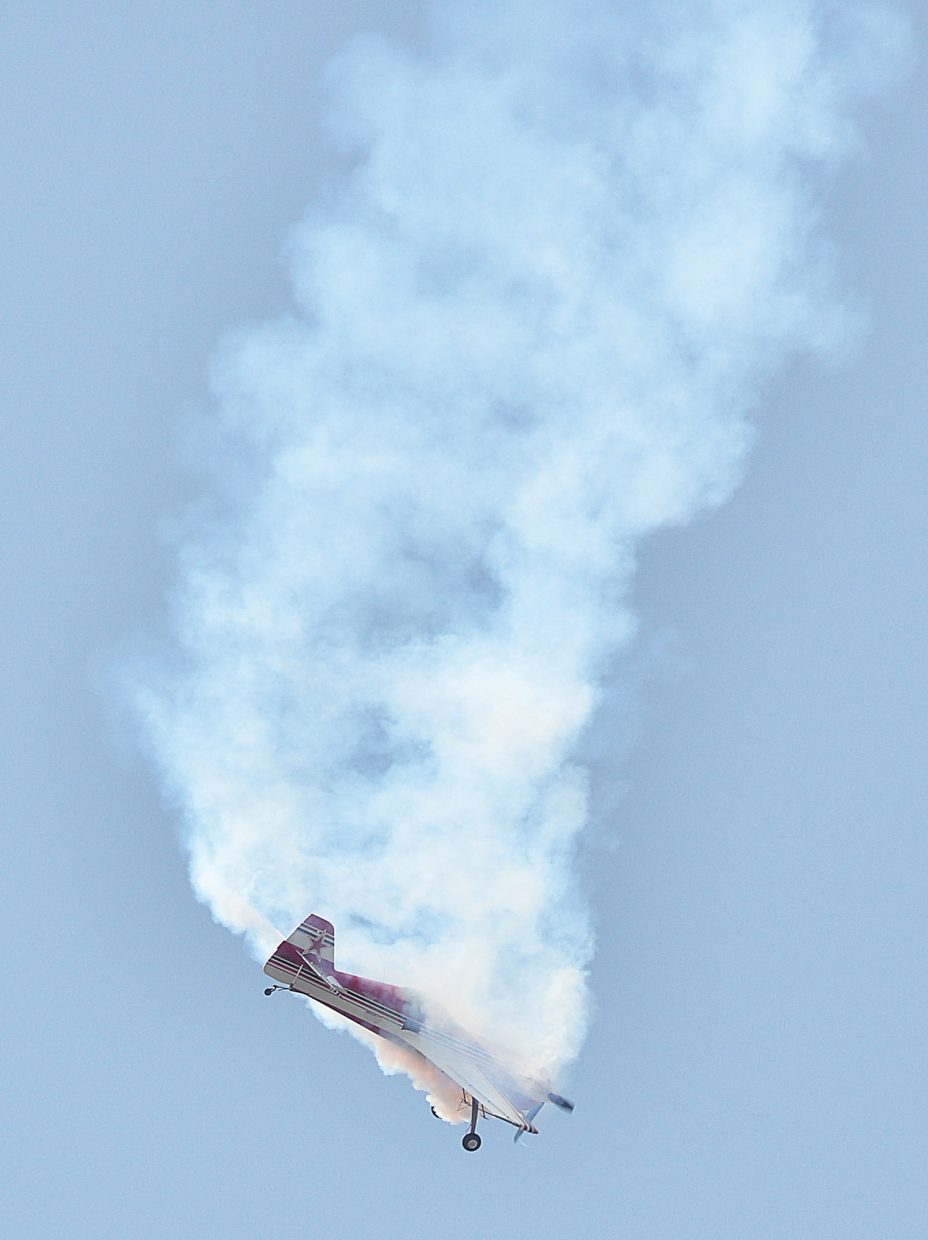 Stunt pilot Don Nelson falls through a cloud of smoke high above the Steamboat Springs Airport on Friday morning in his Sukhoi 26 while practicing for an air show that will be part of the 10th annual Wild West Air Fest, which will take place Saturday and Sunday at the Steamboat Springs Airport. The show will take place at 11:30 a.m. both days. Tickets are $10 for adults, $5 for children ages 6 to 12 and free for children under 5.