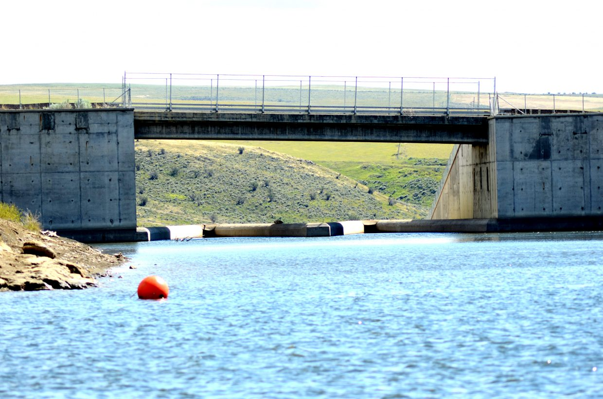 Officials are looking at putting a screen on the spillway at Elkhead Reservoir to prevent the northern pike and small-mouth bass from escaping into the Yampa River and killing the native fish.