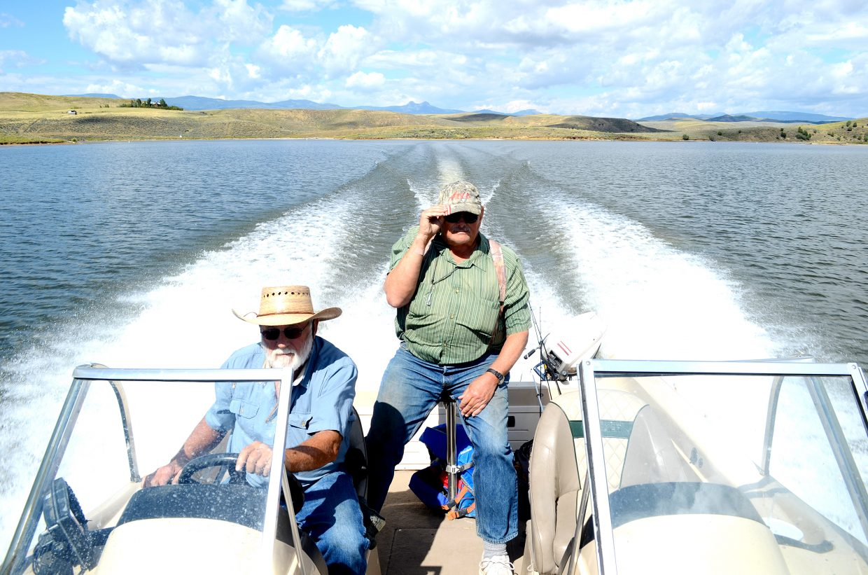 Burt Clements, left, drives his boat on Elkhead Reservoir, where he and his longtime buddy Norm Fedde fish every day.