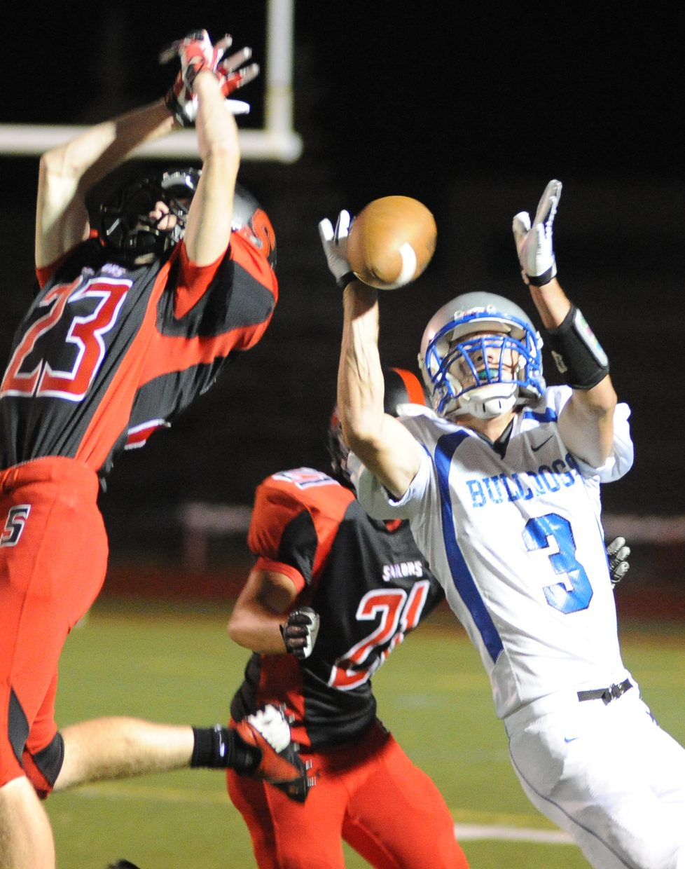 Moffat County's Kearn Gerber reaches for a pass Friday against Steamboat Springs.