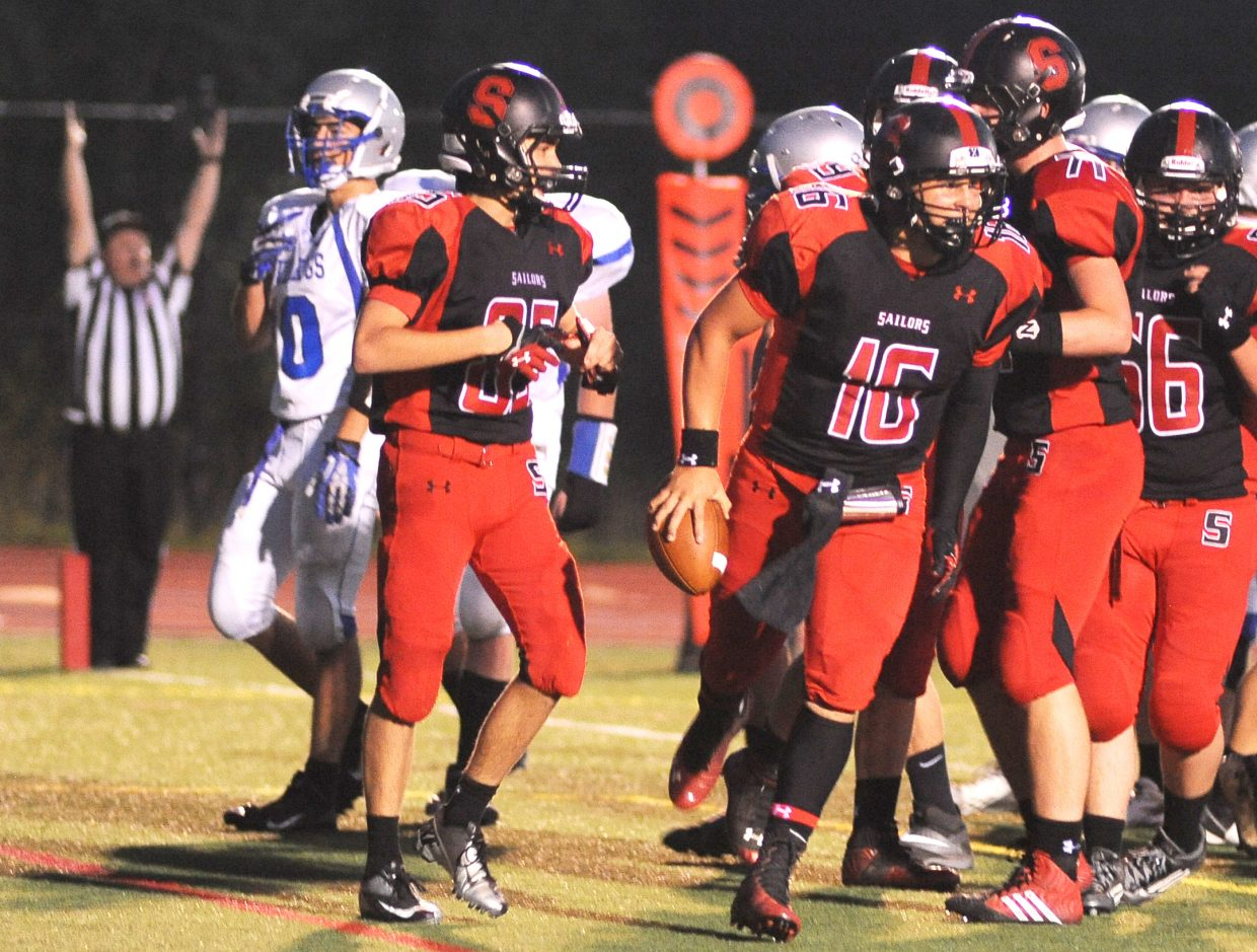 The Sailors celebrate after a Zach Holm touchdown on Friday against Moffat County.