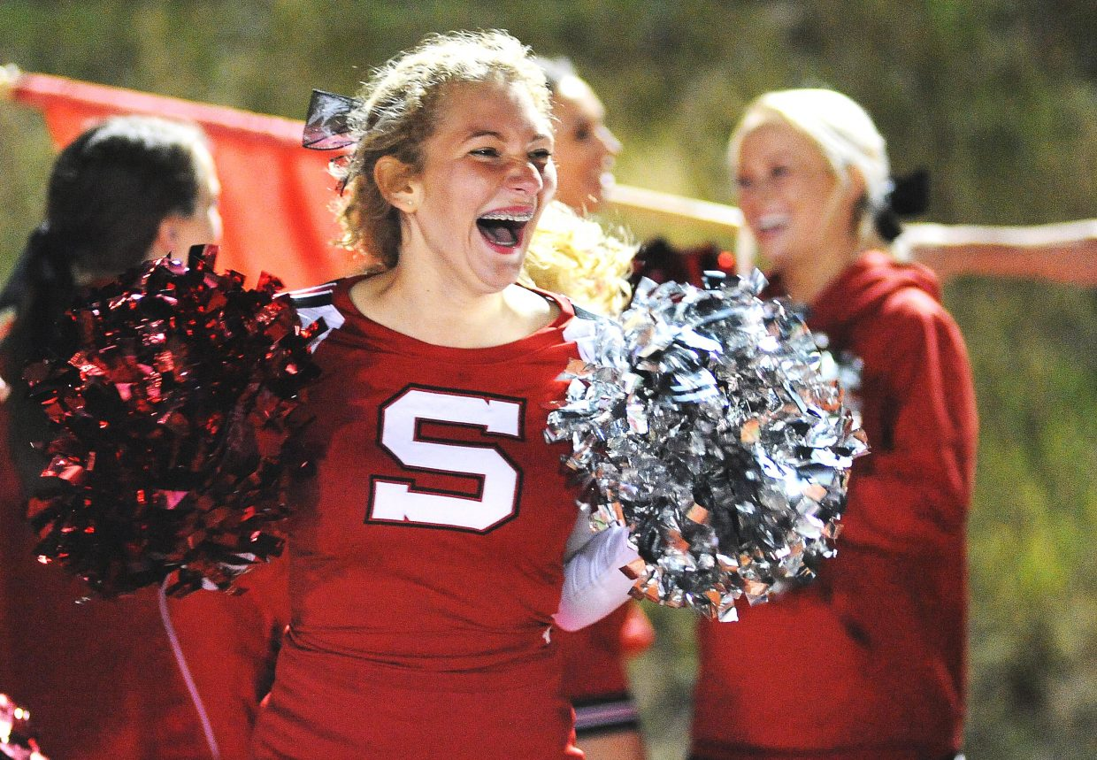 Kelsey Spognardi and the Steamboat Springs High School cheer squad celebrates a second-half touchdown Friday.