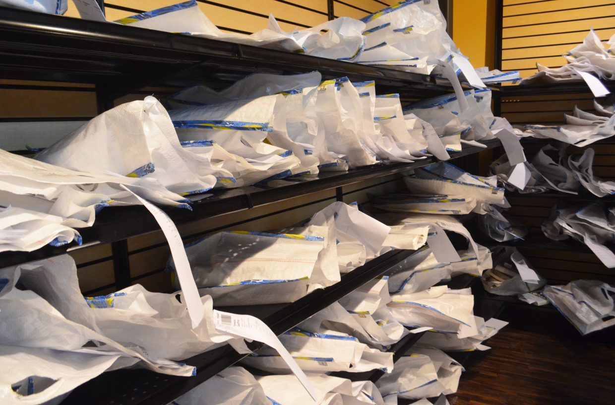 Pre-sorted bags of textbooks sit on shelves in the Steamboat Campus Store at Colorado Mountain College. Rather than order books individually online, Steamboat students are able to pick up all of their books at once for a flat fee this semester.