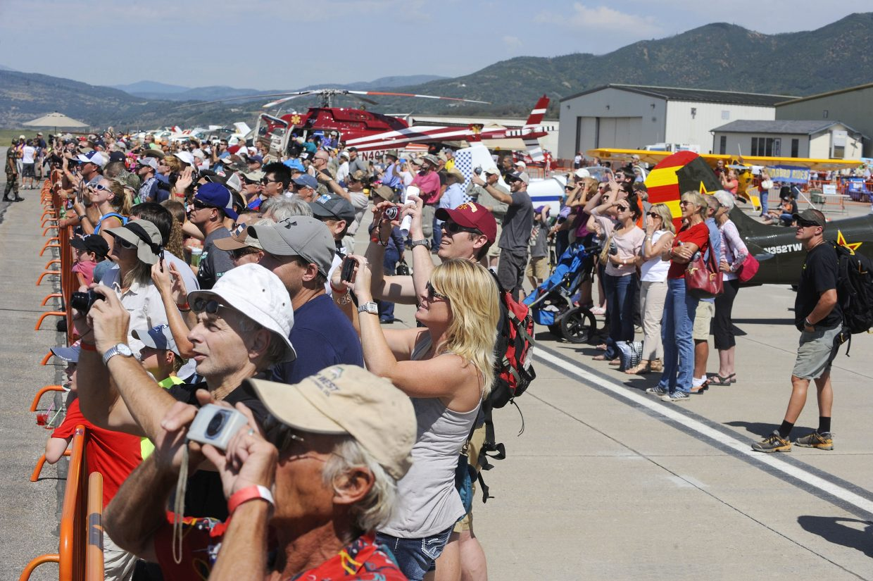 A large crowd gathers to watch Don Nelson fly his Sukhoi 26 during the Wild West Air Fest on Saturday at Steamboat Springs Airport. The air festival continues Sunday.