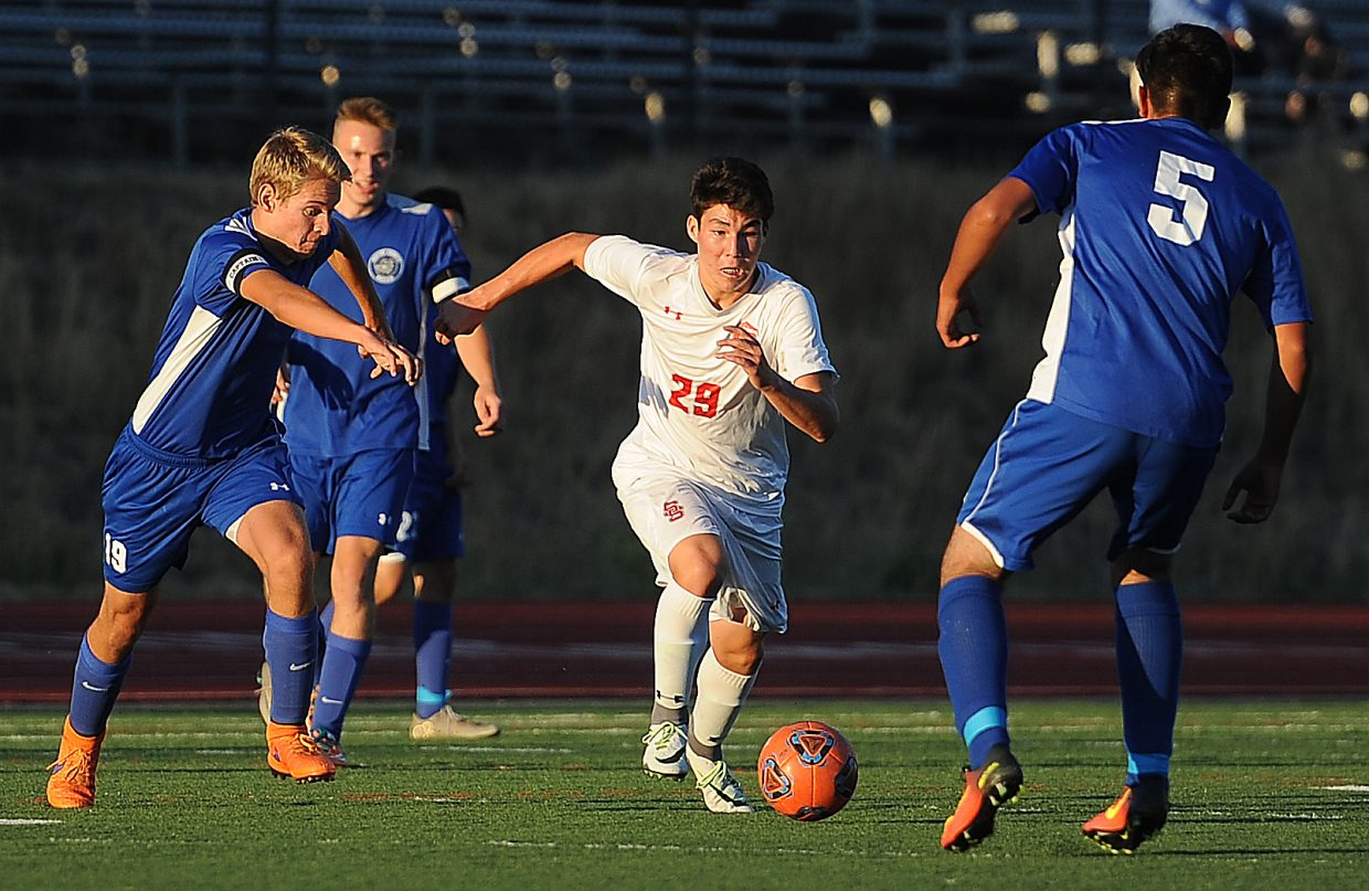 Steamboat Springs' Marat Washburn and a pack of Moffat County defenders chase the ball down the field Tuesday.