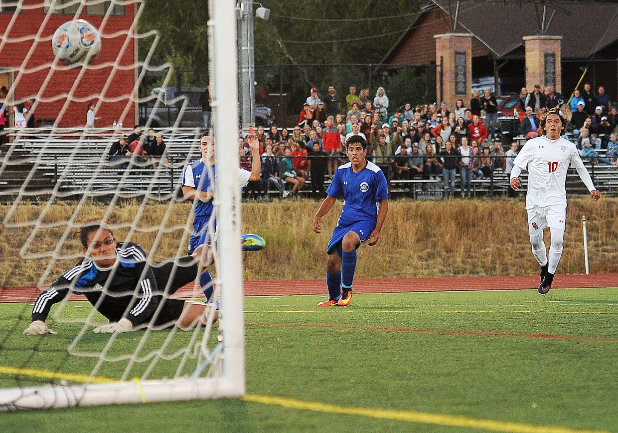Steamboat's Cruz Archuleta, right, watches as his shot sails into the net after it glanced off Moffat County goalie Daniel Moore's gloves. That first-half goal gave the Sailors a lead they never gave up as they won, 3-0.