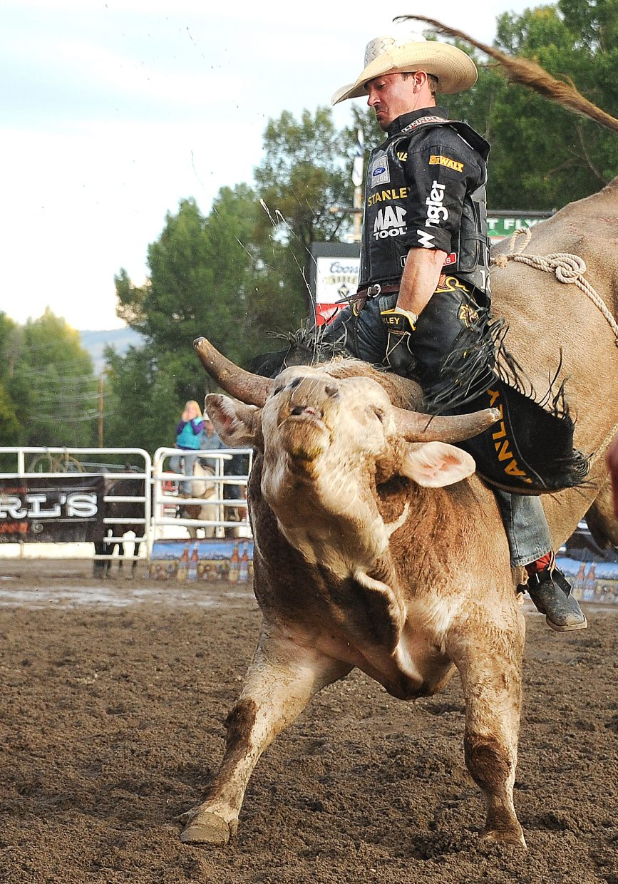 Kody Lostroh hangs on to Rocky Mountain Stanley on Sunday night during the PBR Bull Bash in Steamboat Springs. He rode the bull for 87 points, winning the event.