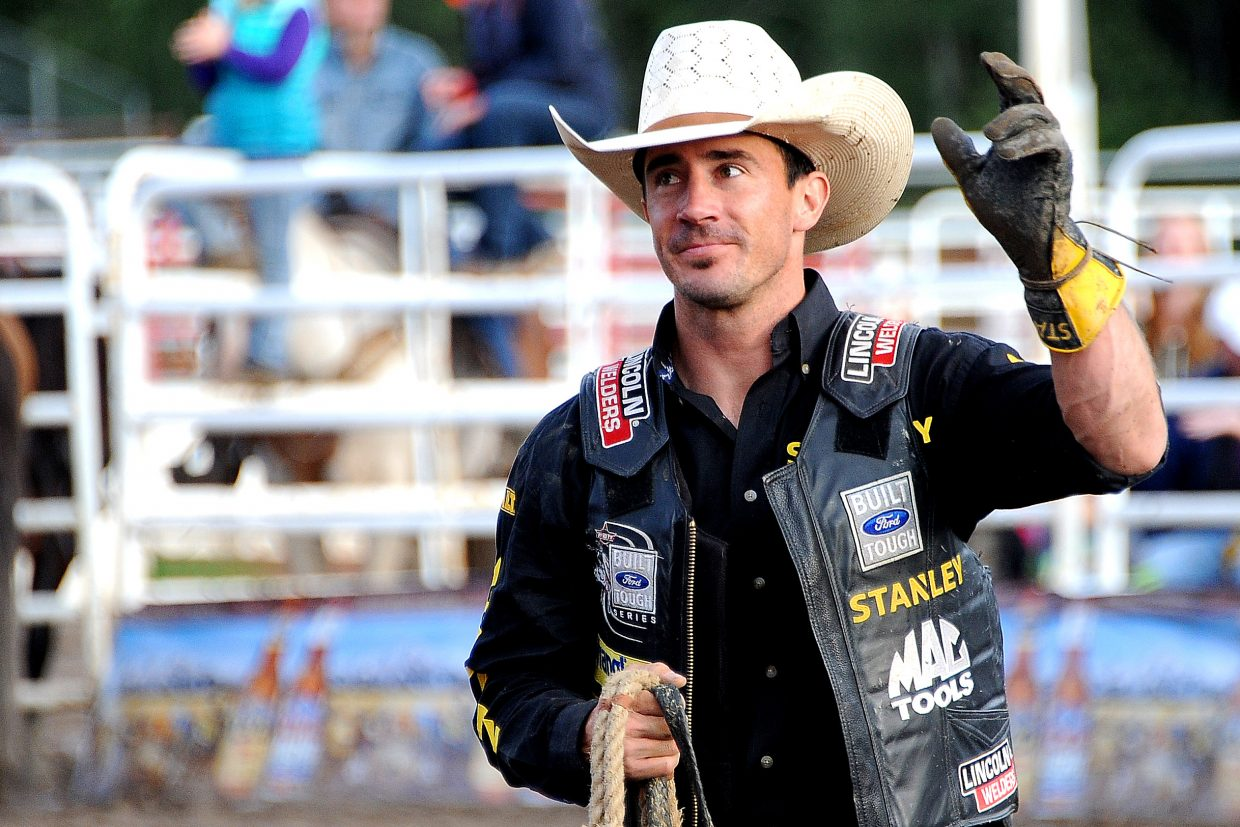 Kody Lostroh waves to the crowd after winning Sunday's PBR Bull Bash event in Steamboat Springs.