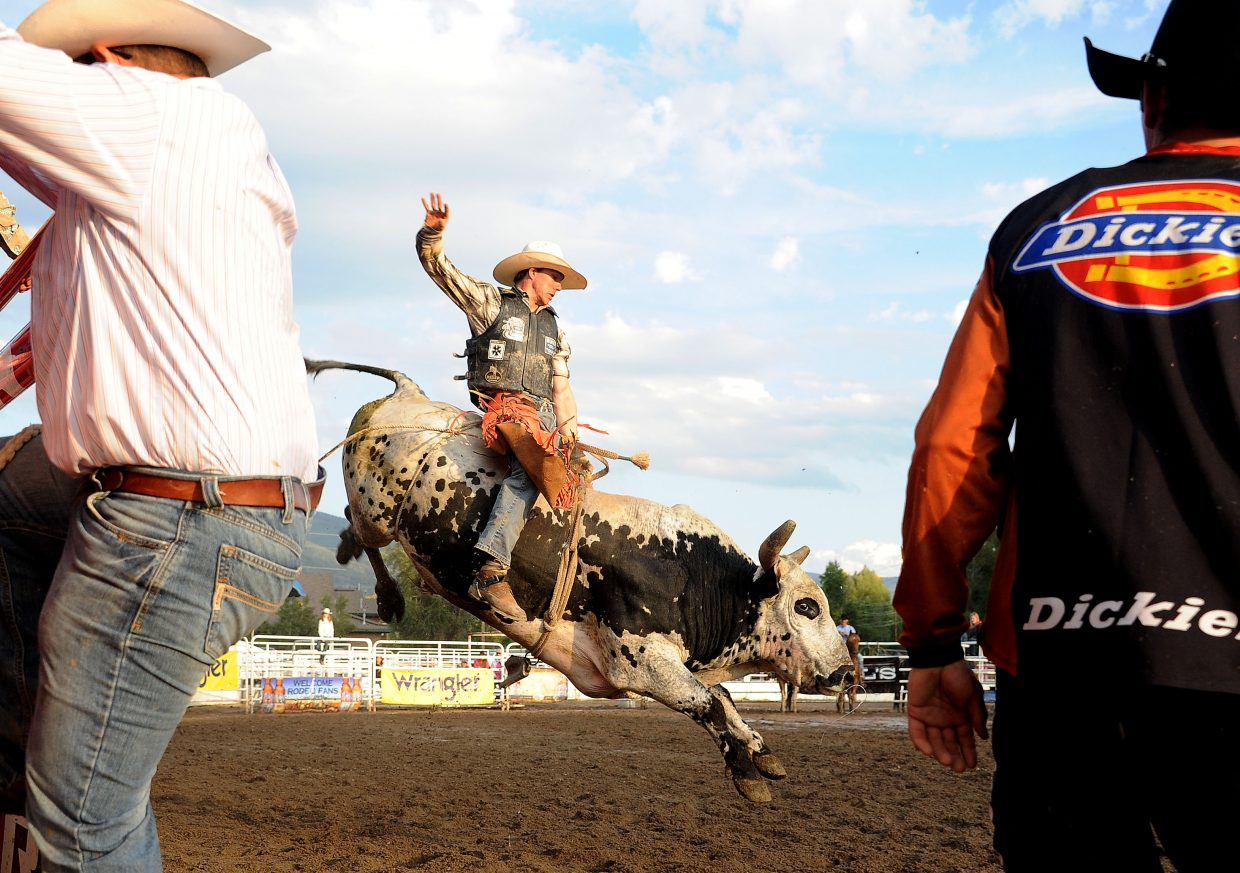 A cowboy hangs on during Sunday's PBR Bull Bash event in Steamboat Springs.