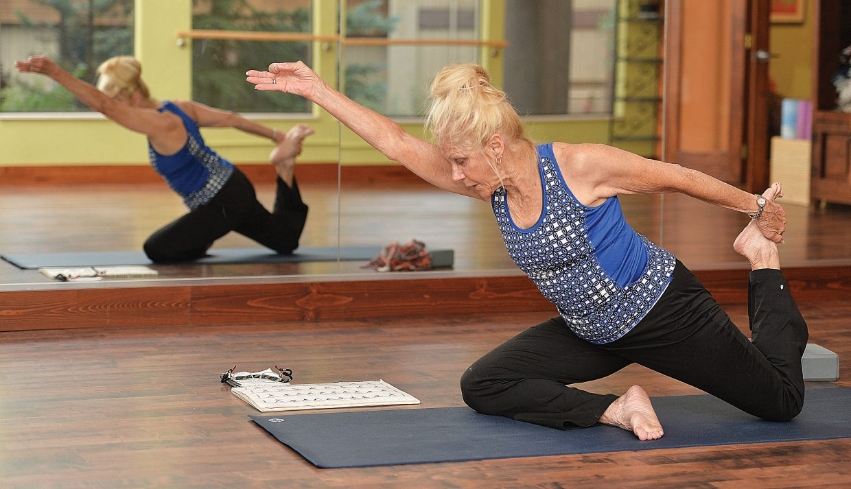 Yoga Instructor Anne Clardy runs through a few moves at the Sundance Studio on Thursday morning in Steamboat Springs. Clardy, in her early 70s, said practicing Yoga keeps her young.