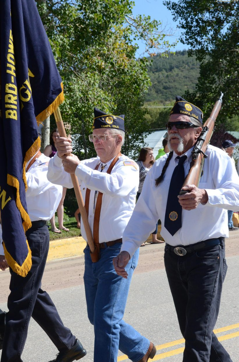 Members of American Legion Post 189 of Yampa led Oak Creek's annual Labor Day parade Monday. Pictured, from left, are Gary Burkholder and Jim Artz. Also participating in the color guard but not pictured were Richard Villa and Joe Edwards.