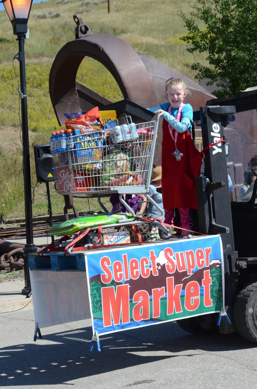 The Super Select Market in Oak Creek was one of about 25 entries in Monday's Labor Day parade in Oak Creek. Kids along the parade route were able to fill bags full of candy, which was thrown during the event.