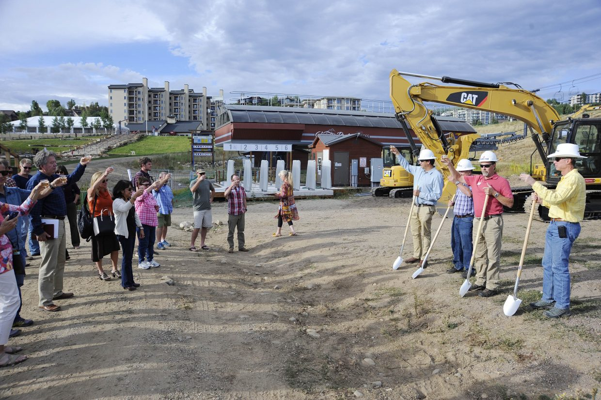 People raise their glasses to celebrate the beginning of construction on the new Maverick's Mini Golf and Outlaw Mountain Coaster on Thursday at the Steamboat Ski Area. The ski area plans to have both attractions completed by next summer.