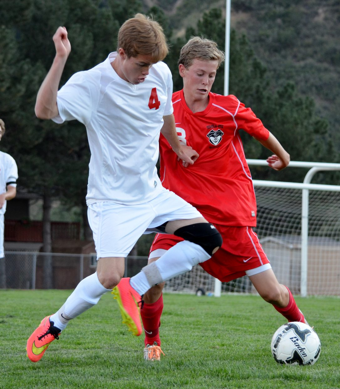 Glenwood Springs High School's Will Osier, left, battles for possession of the soccer ball with Will Beurskens, of Steamboat Springs, during the first half of a Class 4A Western Slope League soccer match at Stubler Memorial Field on Tuesday. The Sailors beat the Demons, 2-1.