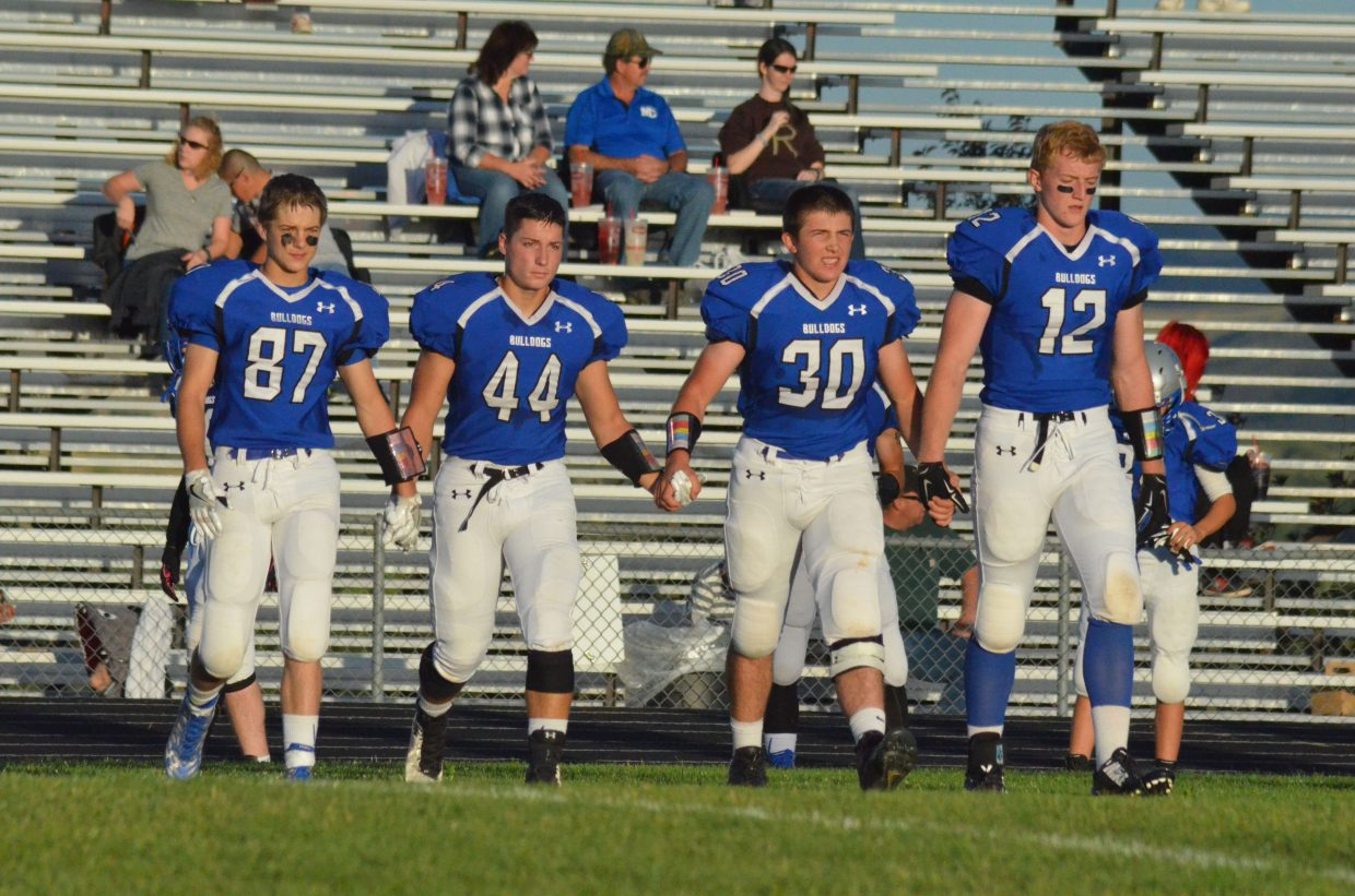 The Moffat County High School varsity football team captains head to midfield for the coin toss to start the game Friday against Ridge View Academy at the Bulldog Proving Grounds. From left, Ryan Zimmerman, Eddie Smercina, Elias Peroulis and Keenan Hildebrandt.