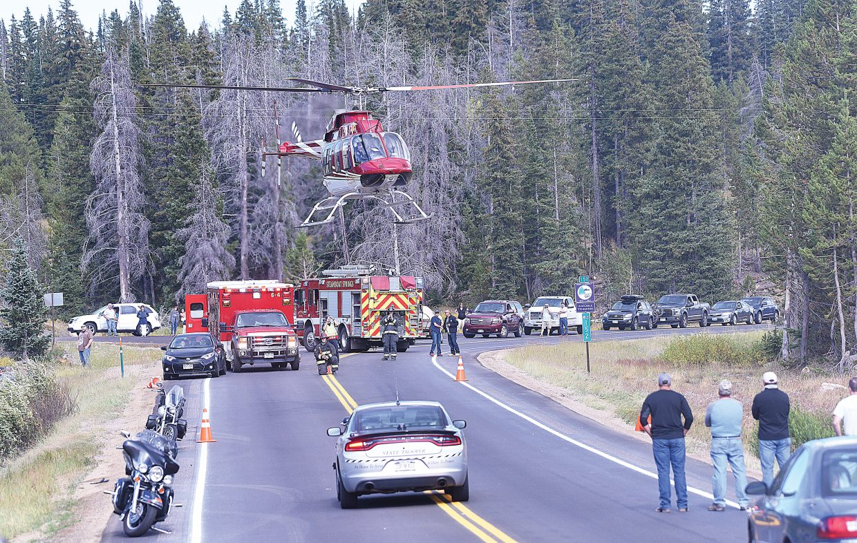 A helicopter from Classic Air Medical lifts off from U.S. Highway 40 near mile marker 152 after picking up the victim of a motorcycle accident. The Colorado State Patrol, which was just beginning to investigate the accident, said it appears the motorcycle, carrying a driver and a passenger, was westbound when it drove off the roadway into the gravel alongside the road. Both the driver and the passenger were thrown off the motorcycle as it left the roadway. The driver was transported to Yampa Valley Medical Center in a traditional ambulance, but the passenger had to be flown from the scene to YVMC on the helicopter. The state patrol was not releasing the names of the victims or their conditions late Friday afternoon. The motorcycle was traveling with a group of other riders when the accident occurred, and those riders and other vehicles responded immediately to help the victims.