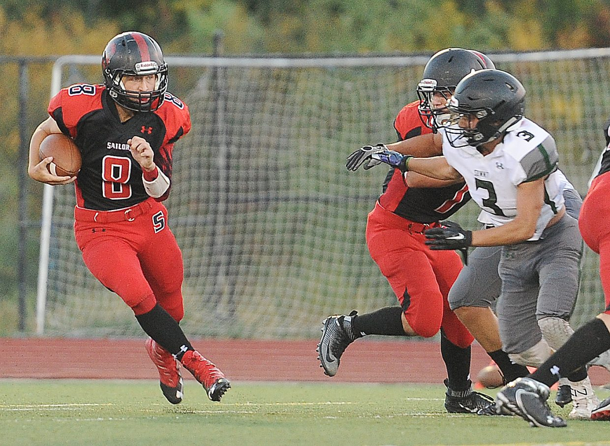 Steamboat quarterback Nate Roach cuts up the field Friday against Summit.