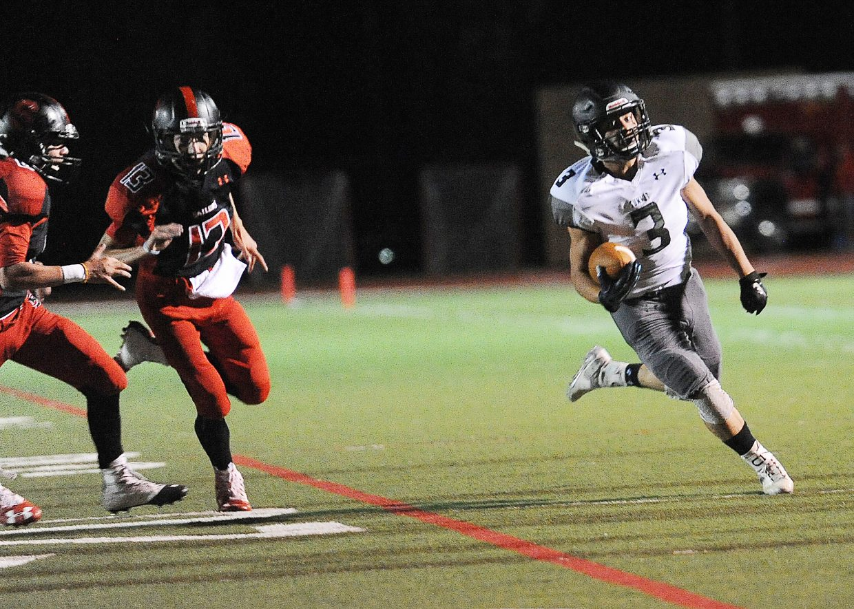 Summit's Adolfo Vasquez heads up the field Friday against Steamboat. He scored two touchdowns and ran for 116 yards to help the Tigers to a 35-7 win.