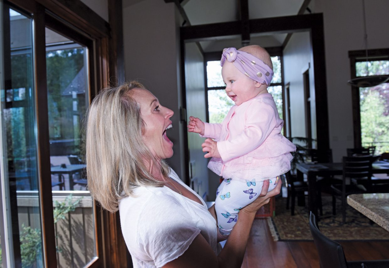 Caroline Lalive Carmichael plays with her daughter, Freya, at her home in Steamboat Springs. Lalive Carmichael came to Steamboat Springs in 1995 with hopes of making the final push to the U.S. Ski Team. She spent 13 years on the team and now calls Steamboat Springs her home.