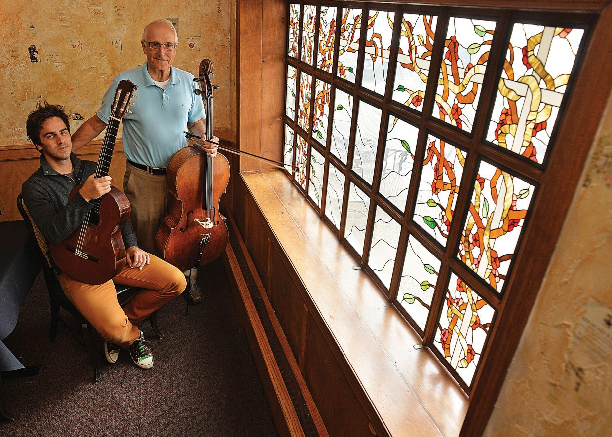 Musicians Mak Grgic, left, and John Sant'Ambrogio pose for a photograph before rehearsing earlier this week. The two will be featured in Duel of the Strings II at 7 p.m. Friday and Saturday at the Chief Theater.