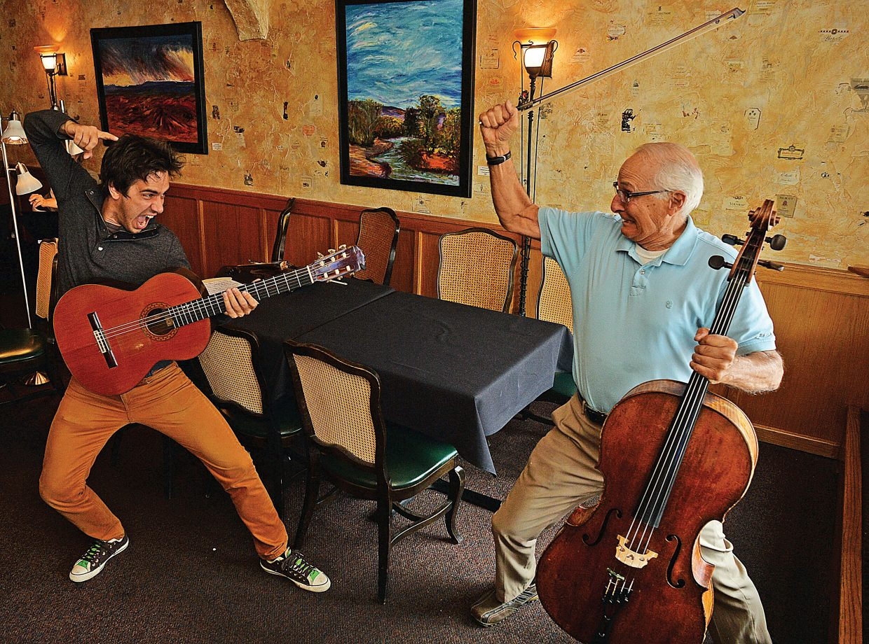 Musicians Mak Grgic, left, and John Sant'Ambrogio horse around before rehearsing earlier this week. The two will be the featured in Duel of the Strings II at 7 p.m. Friday and Saturday at the Chief Theater.