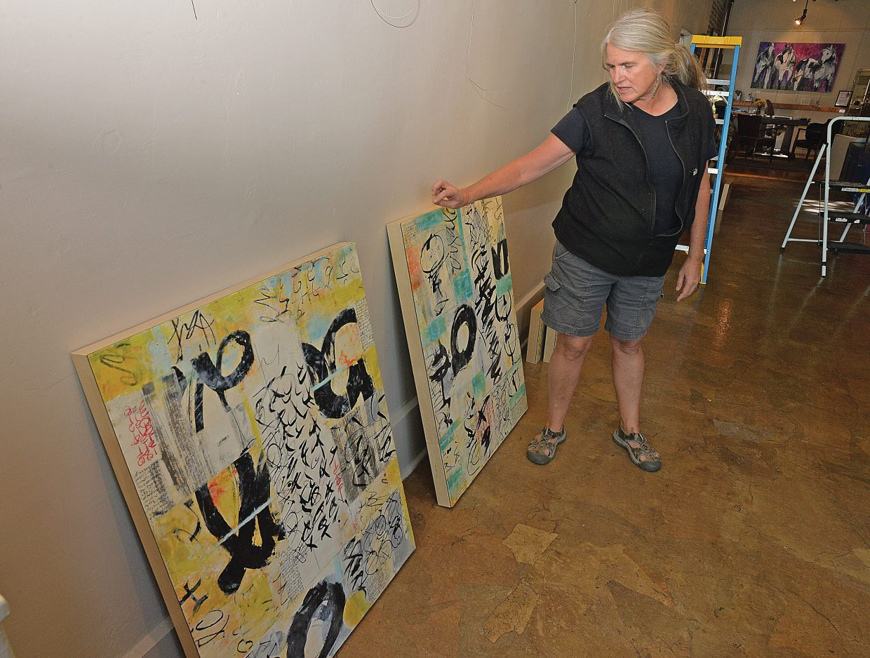 Artist Laura Wait talks about her work while hanging a show at the Circle 7 Fine Art gallery in Steamboat Springs. Wait will be featured this month at the downtown gallery.