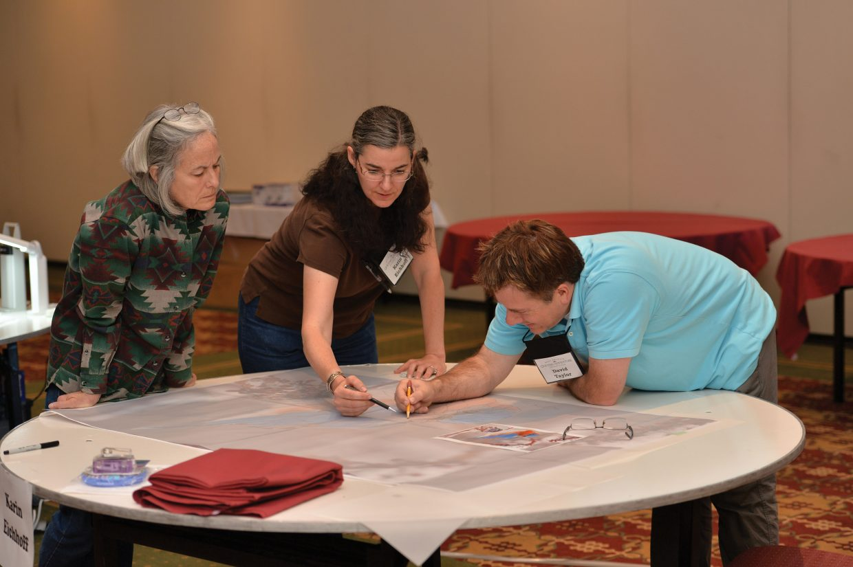 Award-winning quilter David Taylor works with students Karin Eichhoff, middle, and Lynn Olinger during the Rocky Mountain Quilting Adventure this week at The Steamboat Grand. Taylor, who is renowned for his applique process, was joined by another well-known instructor, Sue Spargo, at the workshop.
